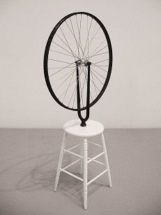 Duchamp's famous readymade, <i>Bicycle Wheel</i>, set an example of art marking for many that utilized found, discarded, and repurposed objects in their work.