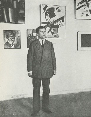 Kazimir Malevich at a Suprematism exhibition