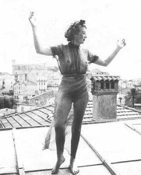 Eileen Agar dancing on a roof in Mougins, France (1937). Throughout her life, Agar was photographed by her friends within the Surrealist movement, often in bizarre or provocative ways, offering snapshots of her personality and appearance as one of her modes of creative expression.