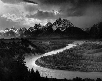 Ansel Adam's <i>Tetons and the Snake River</i> (1942) captures Group f/64's pure photography aesthetic in one of his signature landscapes.