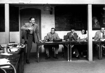 William Heick's photograph (c. 1949) shows David Park, on the left with his foot up on the desk, teaching a class at the California School of Fine Arts.