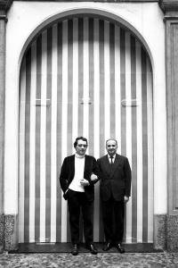 Daniel Buren in front of the blocked-up entrance to Galleria Apollinaire for his first solo show (1968)