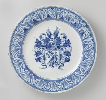 This <i>Armorial Plate</i> (c. 1645-1655) by Willem Jansz shows the Dutch love of Chinese porcelain, which became esteemed in wealthy households, and led to the development of blue and white Dutch Delftware.