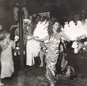 Naomi, a drag queen Goldin often photographed in Boston, modelling in a beauty parade with fans (1974)