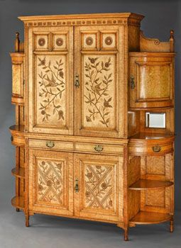<i>Harmony in Yellow and Gold - The Cloud Cabinet</i> (c. 1878) was designed by Godwin and painted by Whistler, who added golden clouds of butterflies on the doors of the side cabinets.
