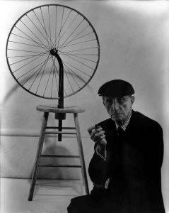 Marcel Duchamp with a version of his <i>Bicycle Wheel</i> (1913) constructed in 1951