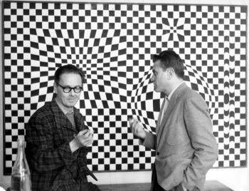 Victor Vasarely (left) in front of one of his <i>Vega</i> series paintings with the Czech-born Argentine sculptor Gyula Kosice (1958)