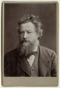 Portrait of William Morris, aged 46, on a cabinet card, by Abel Lewis, printed by James Edward Bruton (1880), National Portrait Gallery.