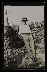 Photograph of Ben Nicholson in a hat leaning against a wall