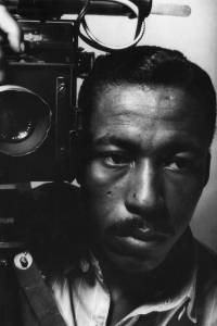 An early self-portrait of Parks with a vintage flash-bulb camera (1946)