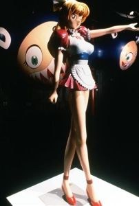 Murakami's <i>Miss Ko2</i> (1997) is an anime inspired sculpture with his recurrent character Mr. DOB in the background.