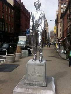 Sculptor Rob Pruitt's chrome Warhol monument, installed near Union Square, New York City, stands at almost ten feet tall.