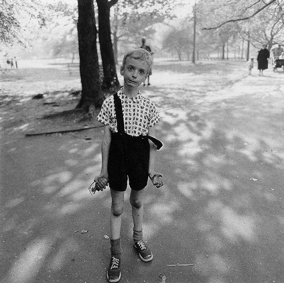 Child with a toy hand grenade in Central Park, N.Y.C (1962)
